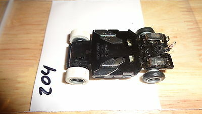 (V4-A*) (Item 204) Tyco Ho Scale Slot Car Chassis Used For Parts Blk Bottom