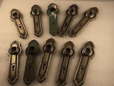 Lot of 10) Stamped Steel Hollywood prop door Handle Backing Plates.      1-381