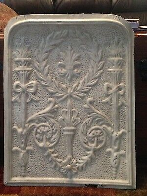 antique tin fireplace cover torch motif