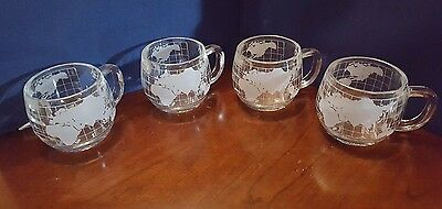 Four NESTLE NESCAFE WORLD GLOBE HEAVY ETCHED CLEAR GLASS COFFEE CUPS