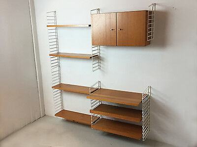 1960's German mid century wall shelving system by Mustering International