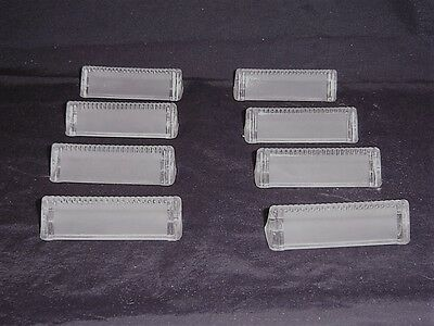 Set of 8 pieces Crystal Place Card/Knife Rests in original box.