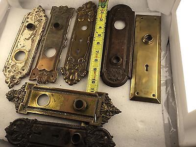 Lot of 7) large ornate Hollywood prop door Handle Backing Plates.      4-411