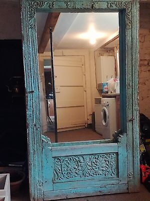 Antique rustic faded blue painted Indian mirror in frame.