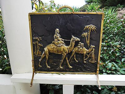 ANTIQUE ENGLISH BRASS FIRE SCREEN DESERT SCENE ARABS AND CAMELS c1928