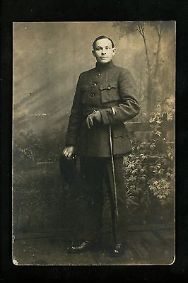 Real photo postcard RPPC Military army soldier in uniform cane gloves WWI 1914