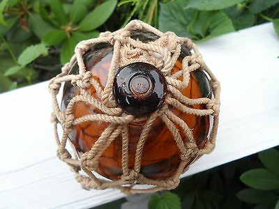 North Western Brown Glass Fishing Float in net