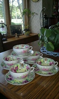 Antique cups and saucers hand painted flowers, gold, & beading bone china signed