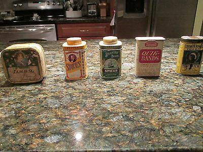 Four vintage tins and one cardboard container