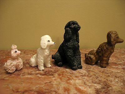 A Group Of 4 Antique And/or Vintage Poodle Figurines.. Porcelain, Chalkware, Etc