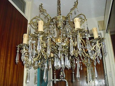 fantastic 8 arm  antique french chandelier with glass droplets .