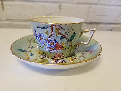 Antique English Hand Painted Porcelain Cup and Saucer with Floral Decorations