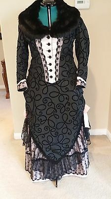 Victorian bustle dress in pink and black taffeta