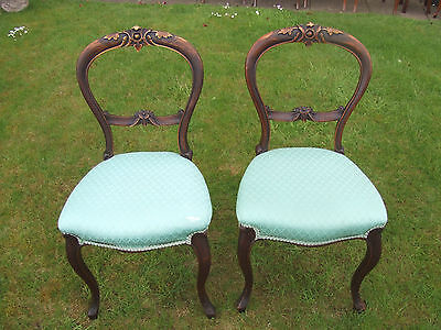 pair of victorian carved  balloon back chairs
