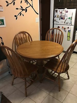 Oak table with 6 matching chairs. table has a leaf.  Only 10 months old.