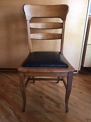 Antique quarter-sawn oak table and chairs