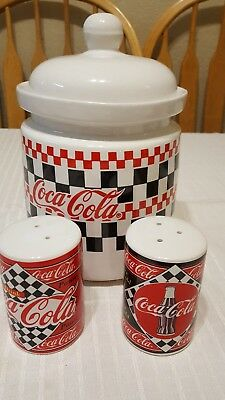 Coca Cola canister and salt and pepper shakers.