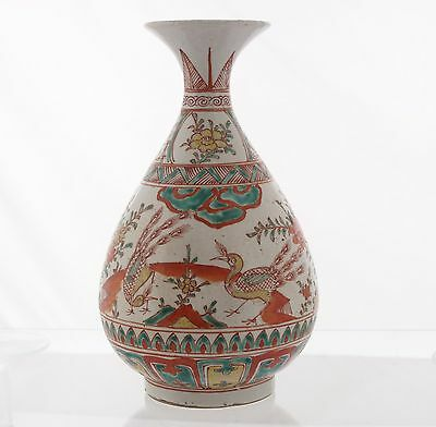 An antique Chinese polychrome pear shaped vase, Ming period
