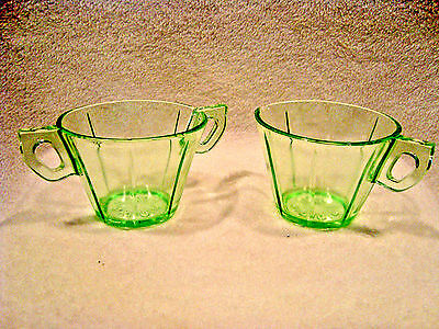 #77 Creamer and sugar in green vaseline glass.