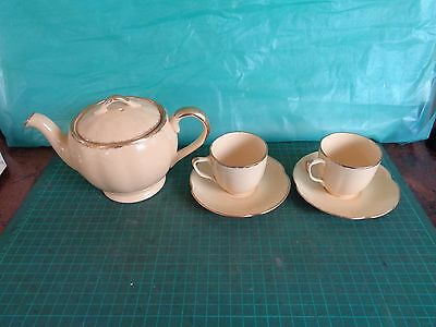 Vintage GRINDLEY teapot and 2 cups and saucers.  Yellow, gold trim