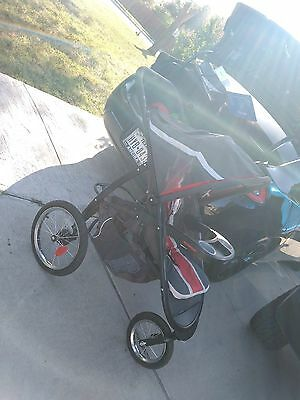 Graco red,grey and black baby jogger stroller with car-seat