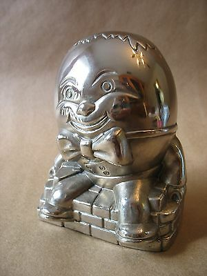 "A vintage silver plated ""Humpty Dumpty"" piggy bank with plug"