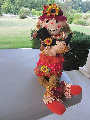 Scarecrow with dangling legs holding her Black & Tan Dachshund Autumn Decor!