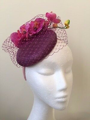 Gorgeous purple fascinator with orchid flowers and netting on a pink headband!
