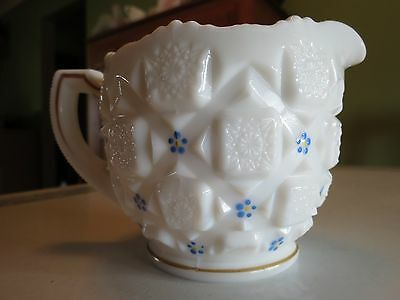 vintage blue and white creamer pitcher with gold trim