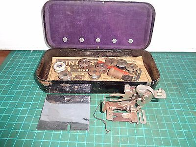 Vintage SINGER sewing machine attachment tin with mixed pieces