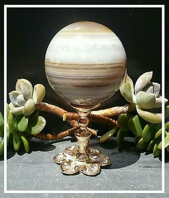 Banded agate gemstone sphere with gold stand