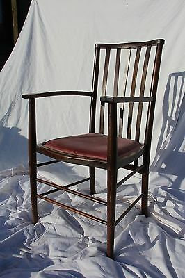 Beautiful dark wood antique slatted back plain shaker style arm chair with cushi