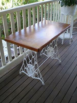 Vintage 1930 Singer Cast Iron frame  painted white with a timber style table top