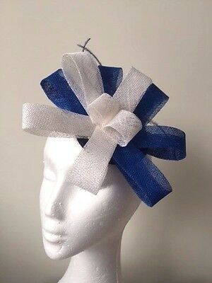 Blue and white sinamay loop fascinator with blue feathers. Stunning on!