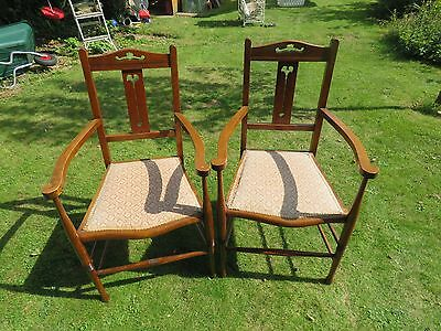 A pair of Arts & crafts style carver chairs with fabric covered seats