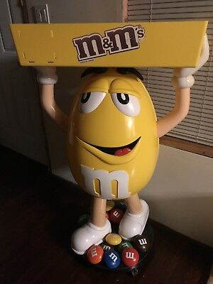 M&M yellow character display with tray halloween prop