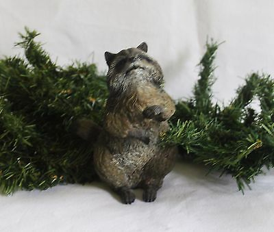 Raccoon figurine use as a decoration for any occasion