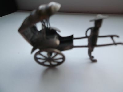 Minature Chinese Metal Rickshaw on wheels with porter was silvered
