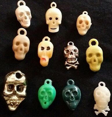 11 SKULL theme cracker jack / gumball machine charms, prizes, toys