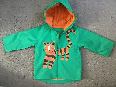 M&S LIGHT JACKET IN GREEN WITH TIGER ACROSS FRONT & ORANGE LINING- AGE 6-9m- NEW