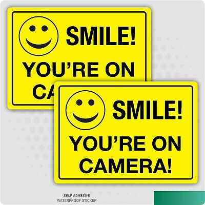 2 x A5- SMILE YOU'RE ON CAMERA- FUNNY CCTV STICKERS SAFETY BUSINESS