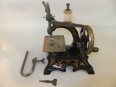 Antique Mini F. W. Muller No. 20 Cast Iron Footed Toy Hand Crank Sewing Machine