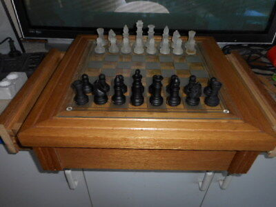 wooden chess board and glass chess set