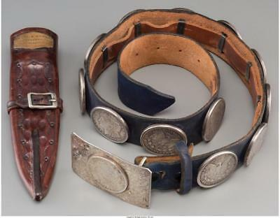 A LEATHER BELT WITH STERLING BUCKLE AND MORGAN SILVER DOLLAR MOUNTS... Lot 66424