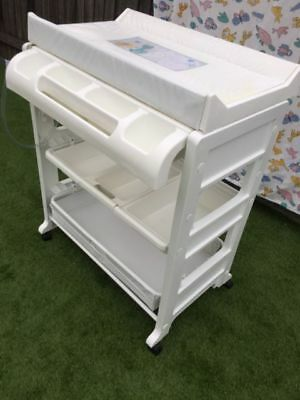 infa secure bath and change table for baby with storage shelves for nappies