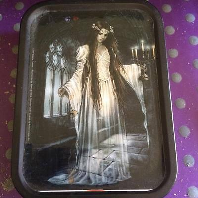 Tin depicting Ghostly Lady