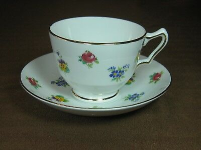 Crown Staffordshire Bone China Cup and Saucer Three Flowers Gold Trim