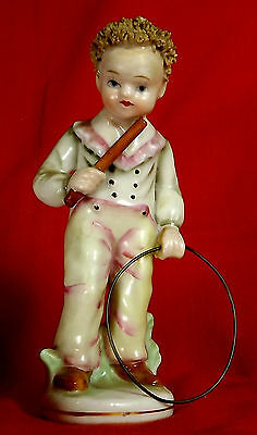 Antique Porcelain Child at Play Figure-Young Boy with toy - Hoop and stick game.