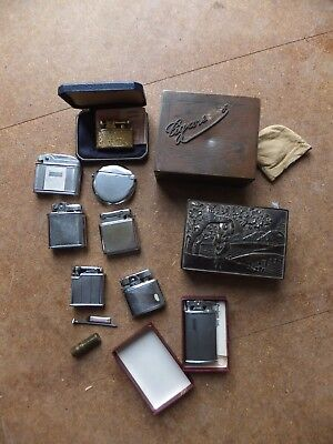 Collection of vintage cigarette lighters and two cigarette boxes for restoration