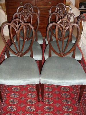 A beautiful set of 6 carved mahogany 'Prince of Wales feathers' design chairs
